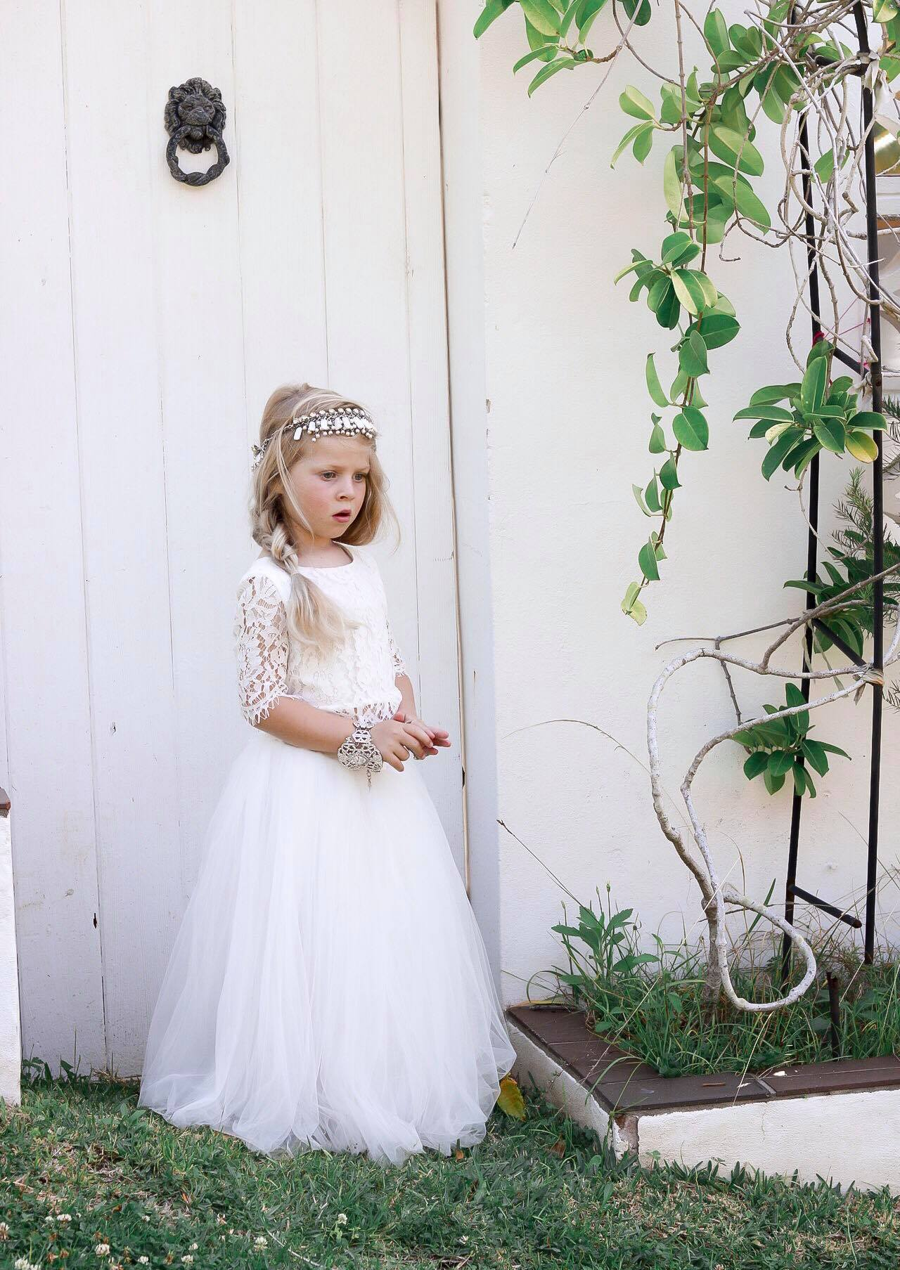 Girl wearing the White Eden Tulle Skirt and Aurora Lace Top