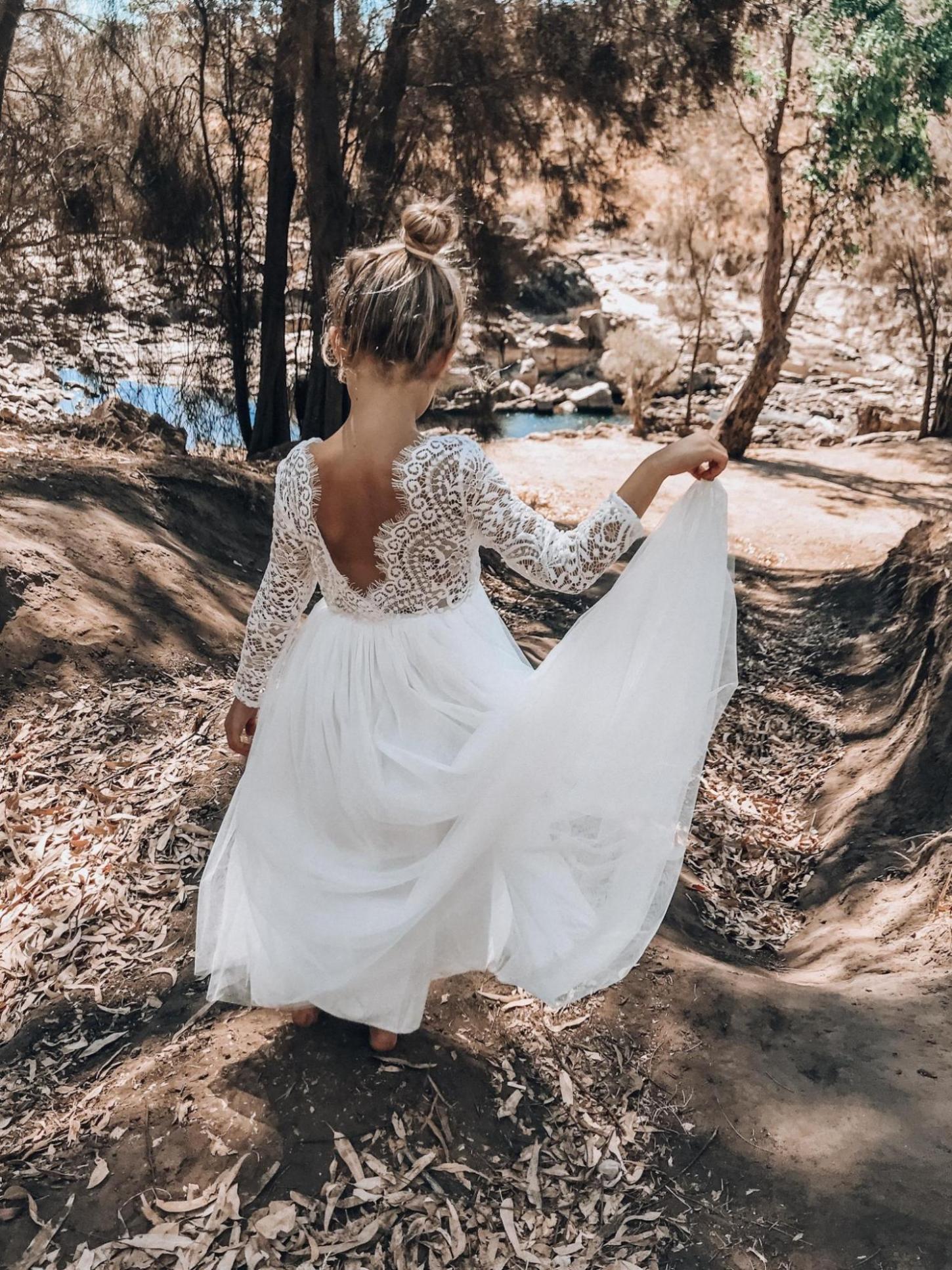 Back shot of the Swan White Long Sleeve Lace Back Dress