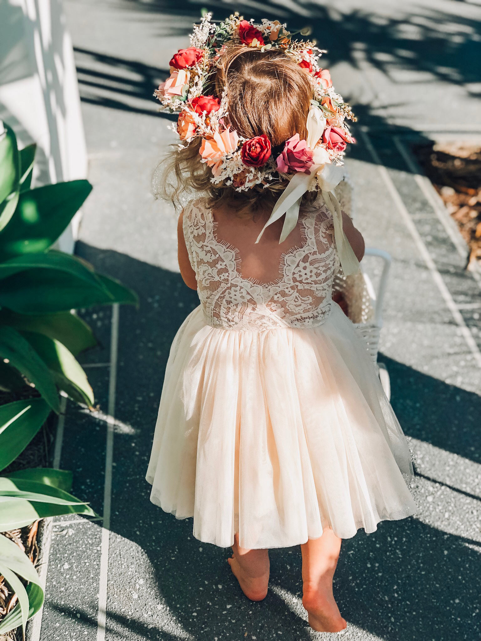Back shot of  Willow in the Aubrielle Light Champagne Sleeveless Dress