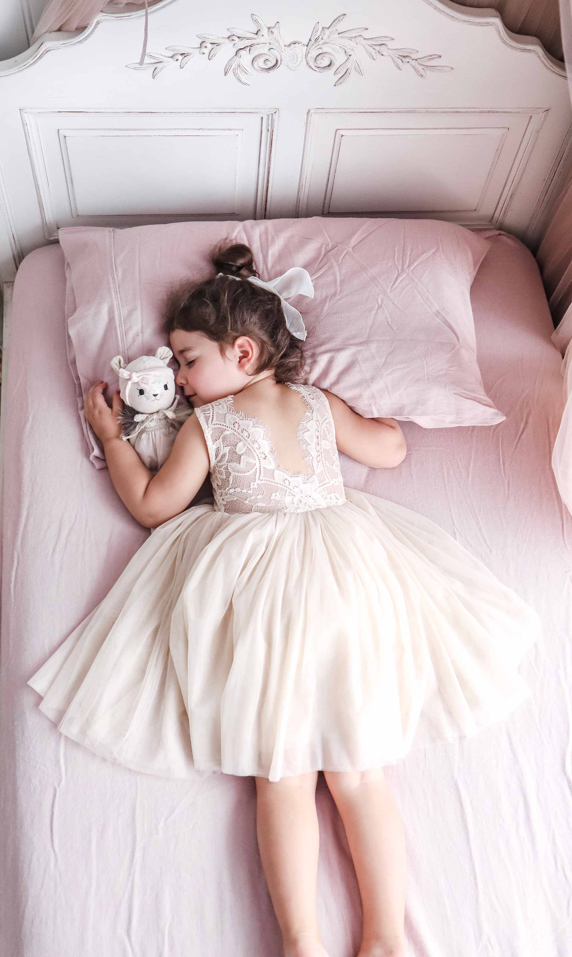 Little girl asleep in the Champagne Chloe Sleeveless Dress